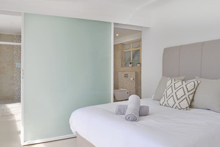 The bedroom gives access to the walkin closet and large bathroom.