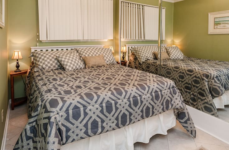 Queen size bed in the bedroom. Close the pocket door for privacy and watch cable TV on the flat screen