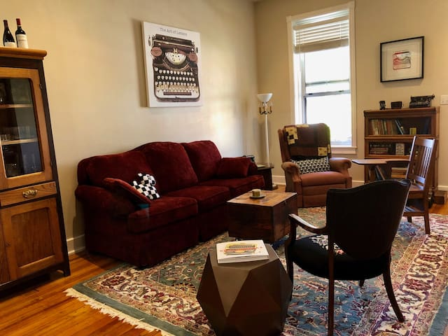The living room is for conversation and drinks. The red velvet couch is cozy and has a pull-out bed. Recliner is super comfortable and great reading chair.