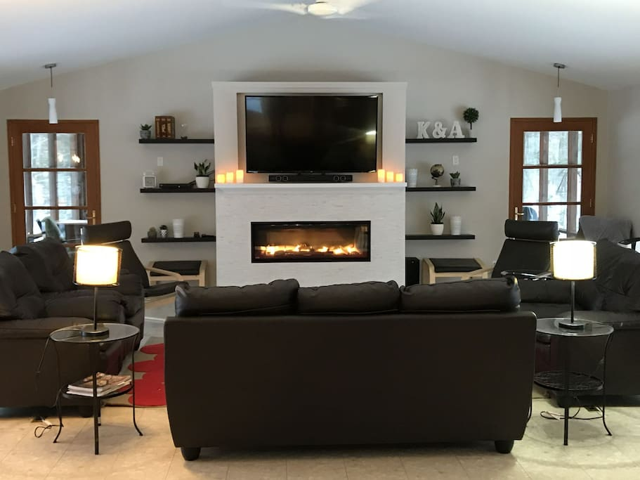 Living area with plenty of comfortable searing, flat screen tv with Satellite service, cosy gas fireplace.  two doors lead to the Muskoka Room.  Lake view to the left, forest view to the right.  Nature surrounds this room.