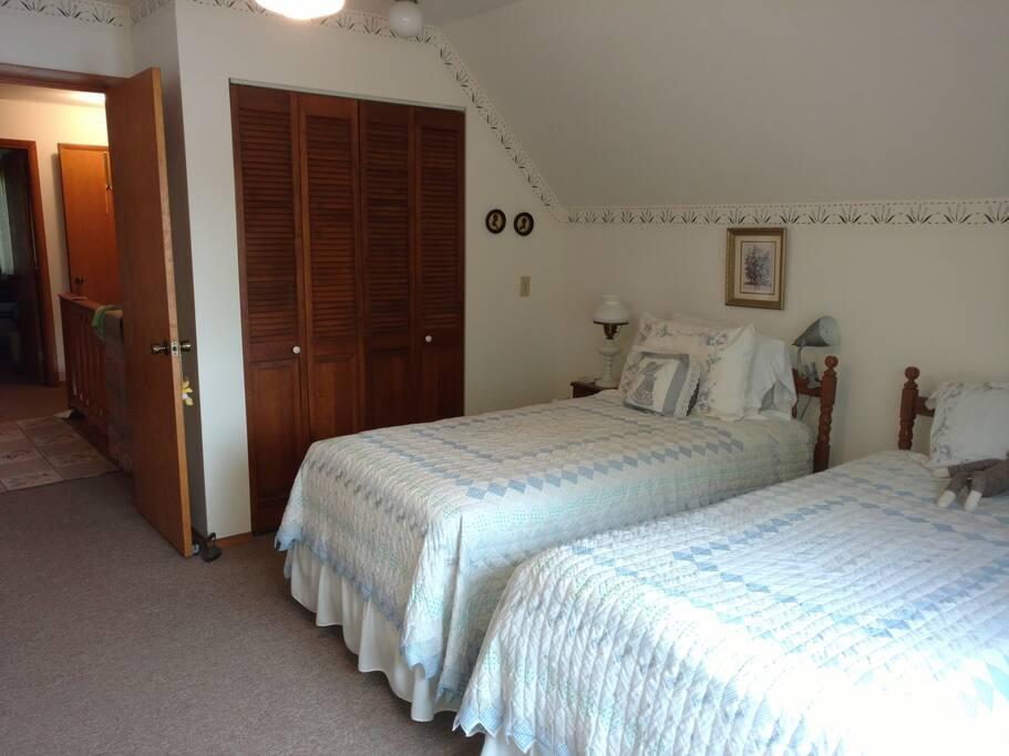 Master bedroom overlooks Bass Lake.