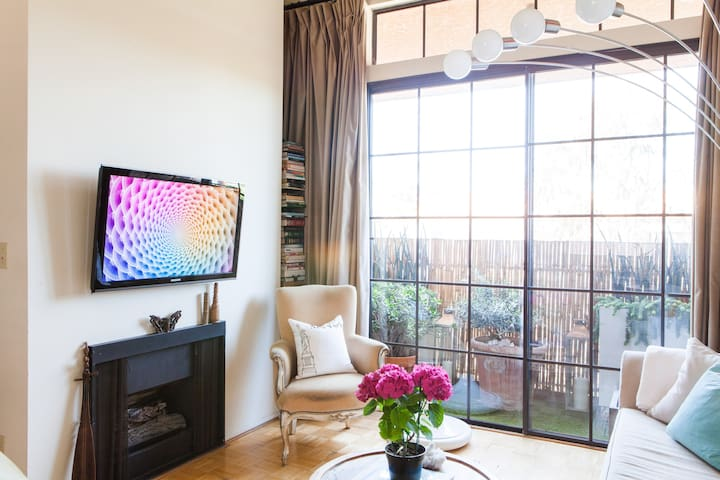 Wall-mounted flat screen TV and gas fireplace
