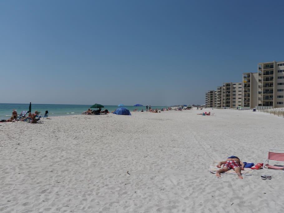 Open white sand beach in front of condo