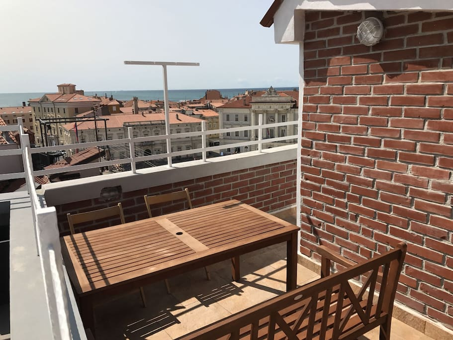 Dine 'al fresco' on your private terrace with great sea view