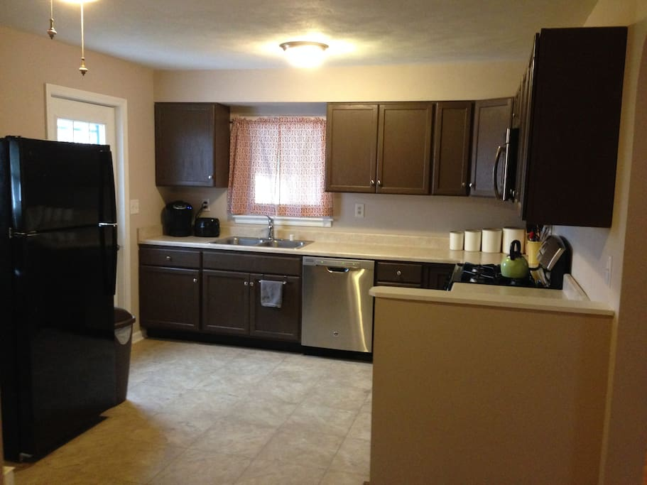 Spacious kitchen with plenty of counter space, gas range, microwave, refrigerator, dishwasher and Keurig coffee maker.