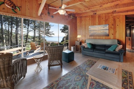 Impeccable oceanview home with private beach access & a large deck!