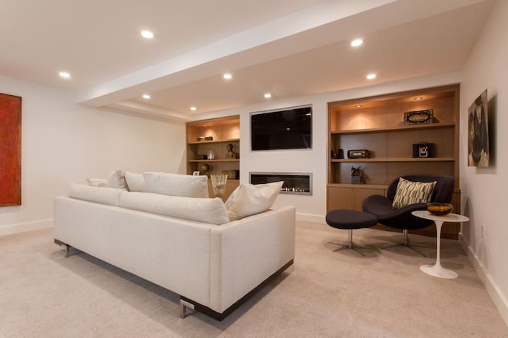 This is your private living room. It is much more than just a room.  It is an entire floor 800 square foot suite privately set on its own lower level of the home.