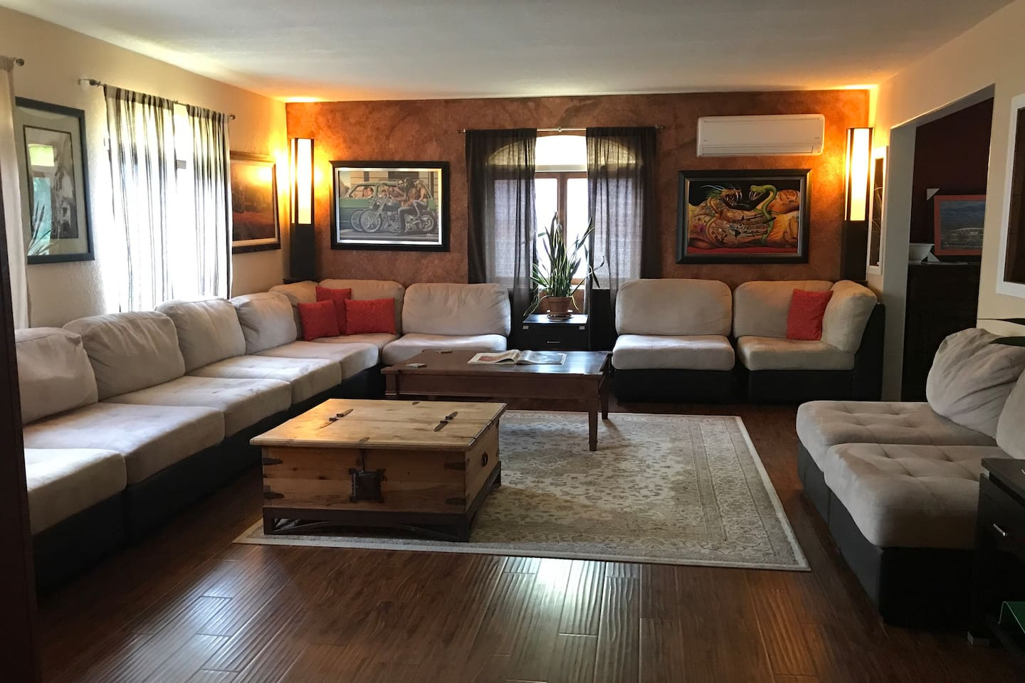 Large main level family room with loads of seating and cable tv
