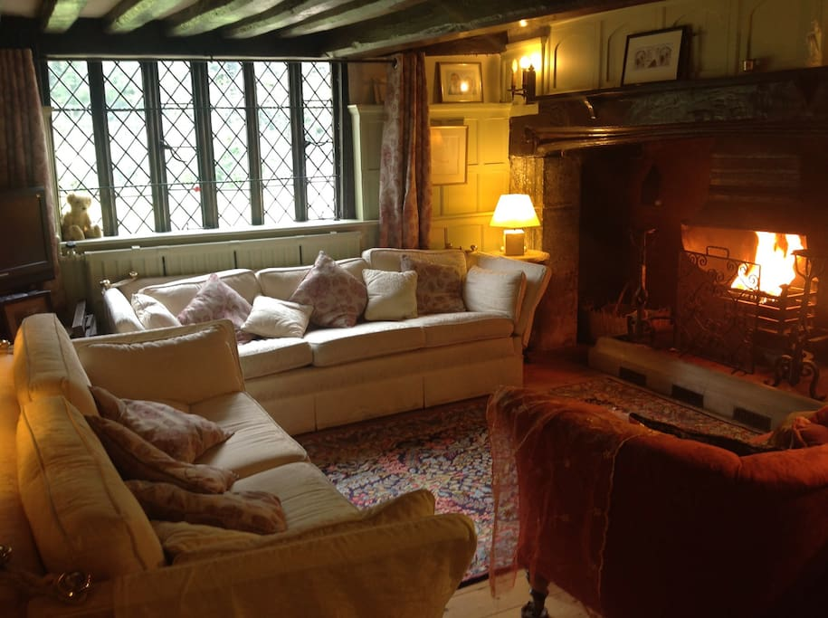 The snug sitting room with its enormous Tudor inglenook