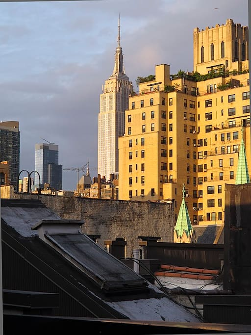 View from the living room -- Empire State building and classic rooftops views