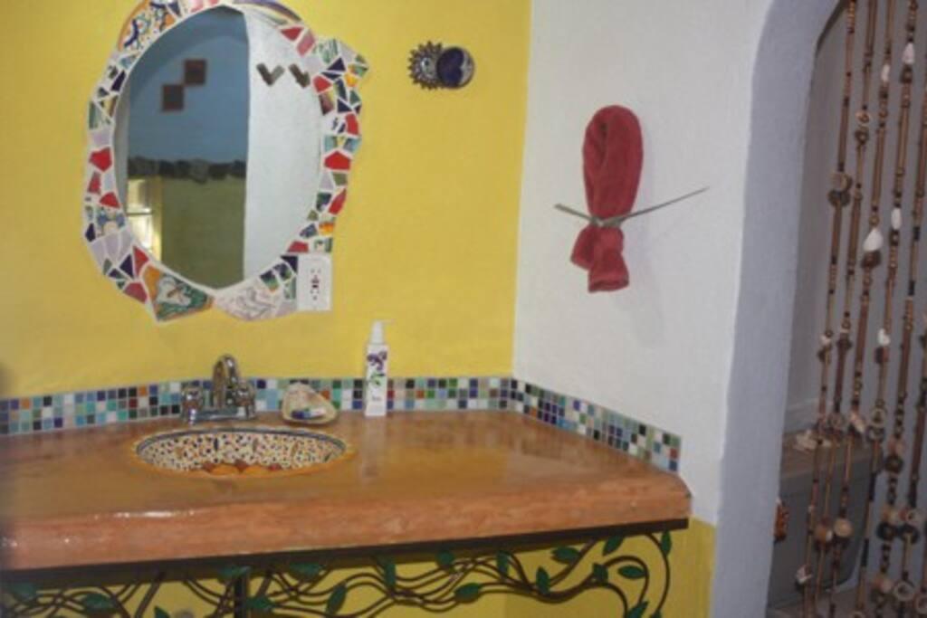 Bathroom mirror with mosaic surround
