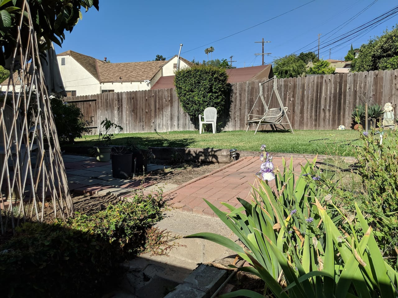 Garden with swing, BBQ and tables