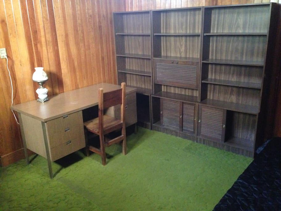 cozy, carpeted, with desk