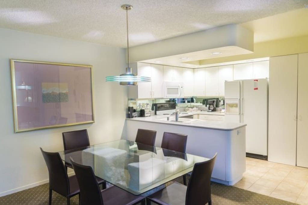 Full kitchen conveniences include refrigerator, microwave, and cooking utensils.