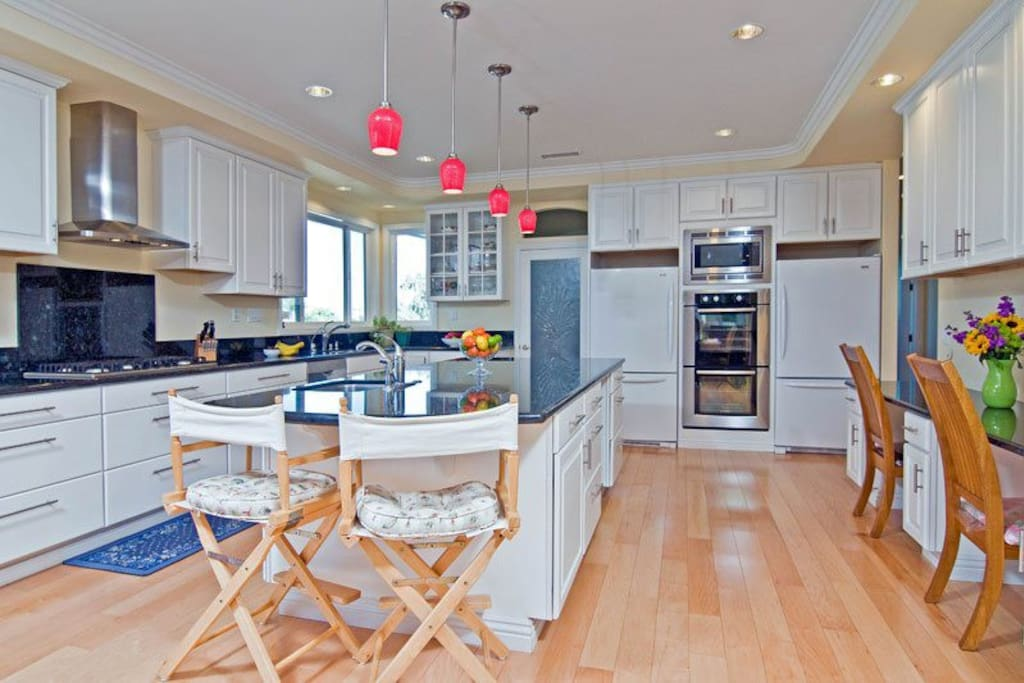 Prepare to enjoy a world-class Chef's kitchen with a walk in pantry, 5 burner stove, two ovens and two refrigerators!