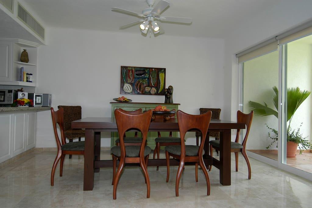 Dining area near kitchen breakfast bar