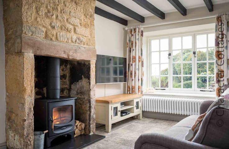 The stunning inglenook fireplace contains a lovely wood burning stove
