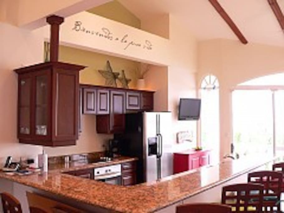 Open kitchen with bar seating & views!