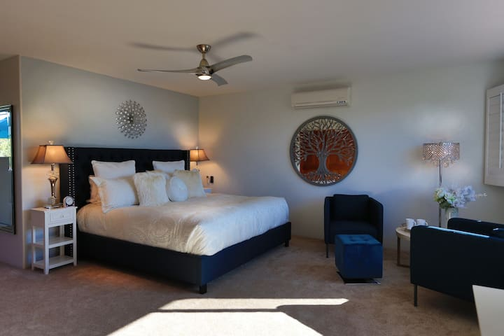 King sized bed on 2nd floor master bedroom with private bath and seating area.