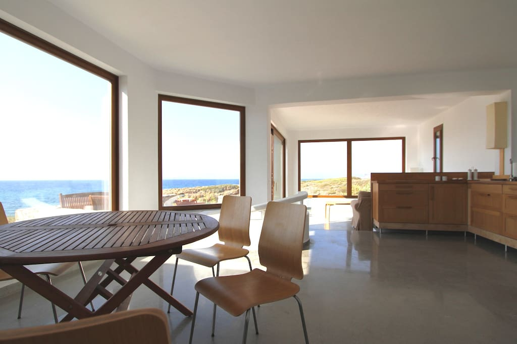 Open plan living area with kitchen, huge windows for fabulous views