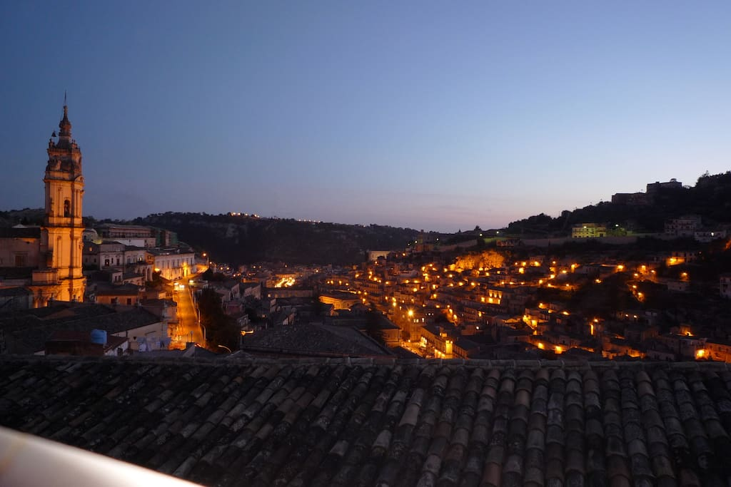 Night view of Modica's dim lights from the terrace