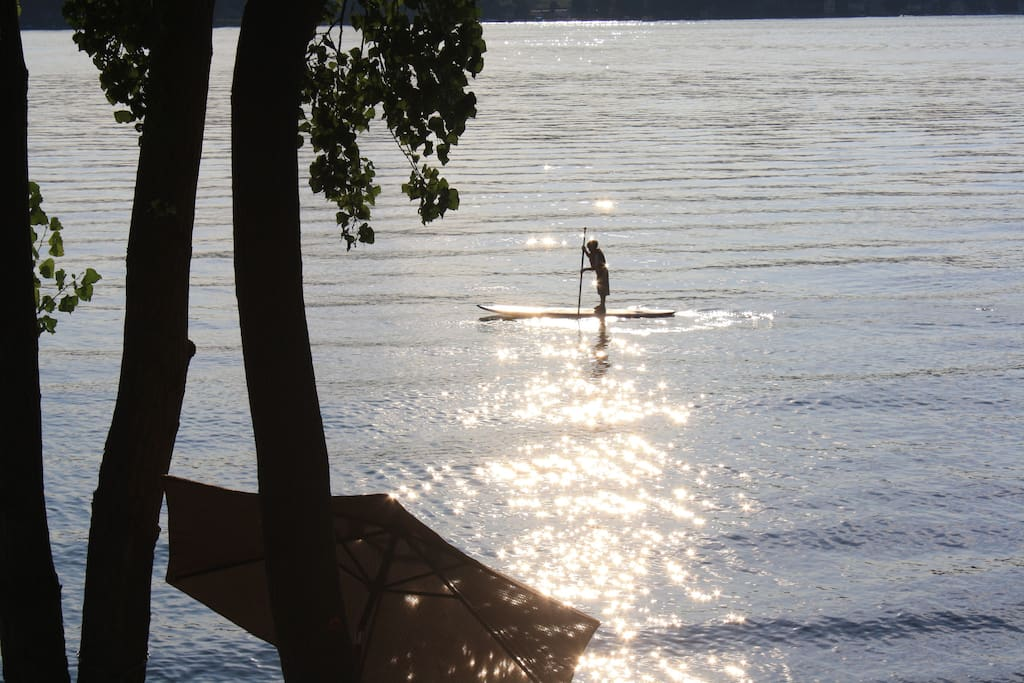 Take the paddle board out beyond the dock for a sunset moment.