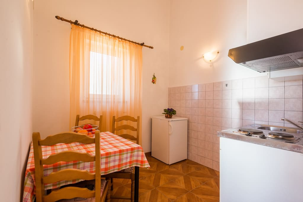 Small kitchen with dining table.