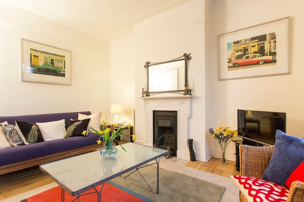 A very spacious Living Room with a cast iron Victorian fire place.
