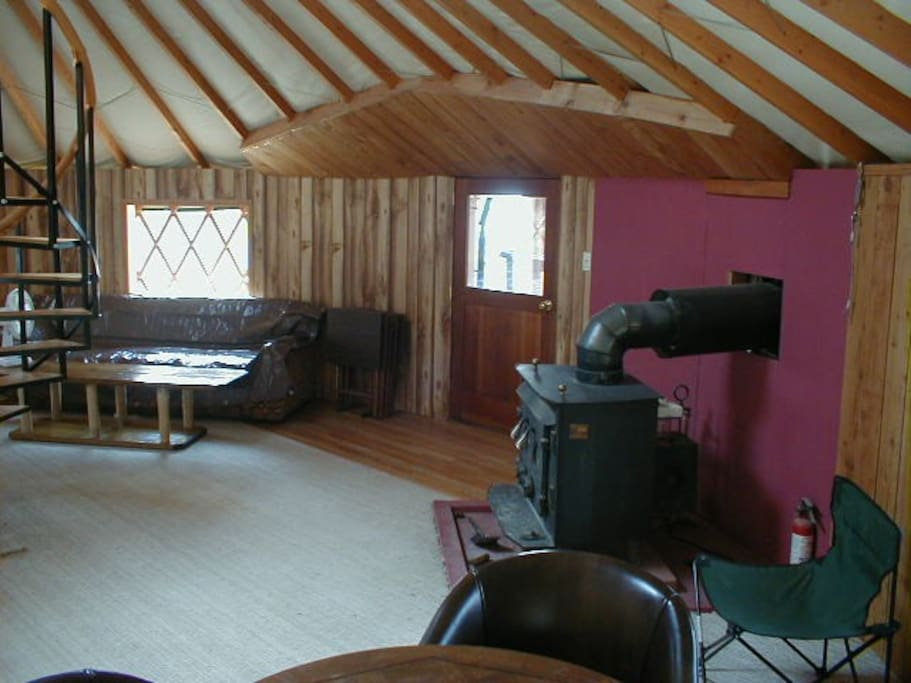 The living room with wood stove for winter comfort.