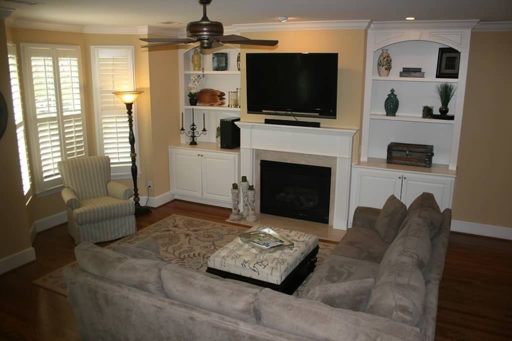 Spacious living room area with flatscreen television and comfortable seating .
