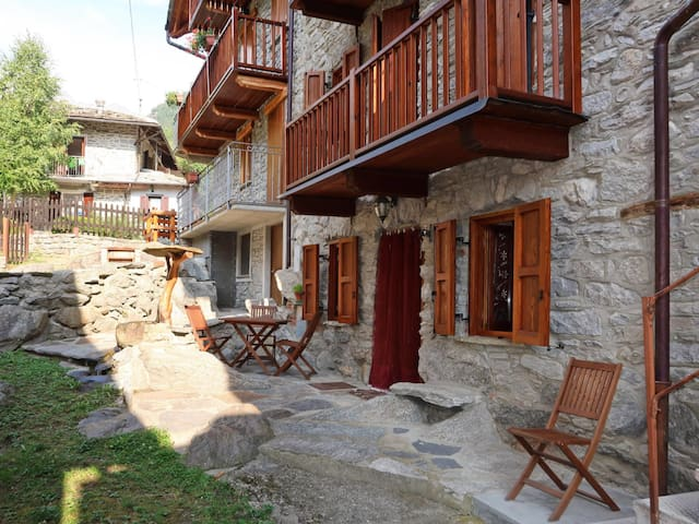 Characteristic stone village house in the winding center of Noasca
