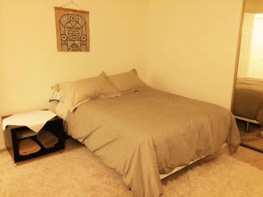 This is the Airbnb bedroom. Double bed and down comforter