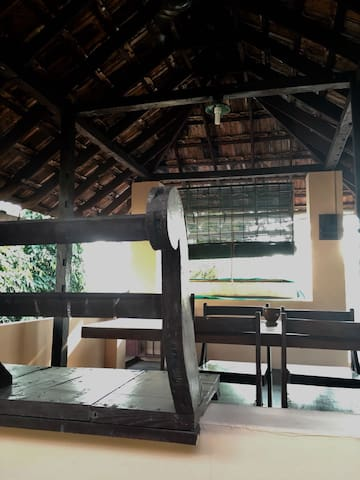 breezy veranda with table and fan for your private use