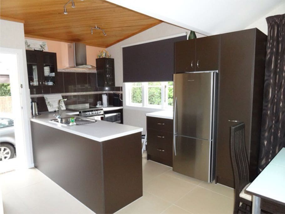 Modern kitchen with all your appliances and utensils