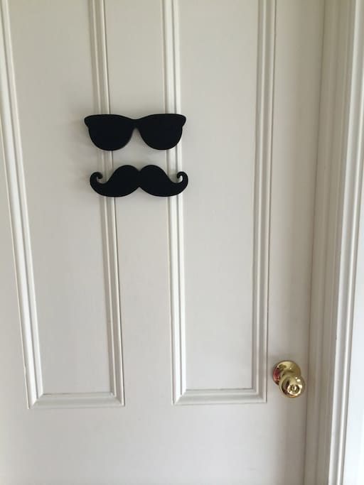 A mysterious Groucho smile welcomes you at the door of your room.