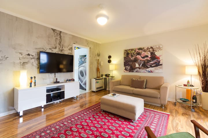 The main living room with large TV.  The artwork has now been updated