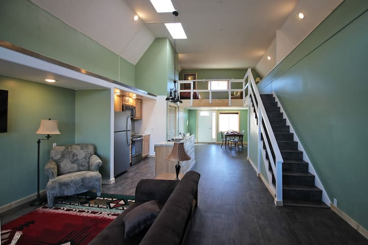 From near the sliding door, a view toward the front illustrating the entire living space