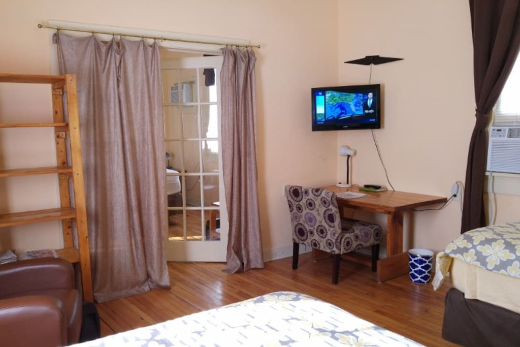 Bedroom with 2 full size beds, air conditioner, TV