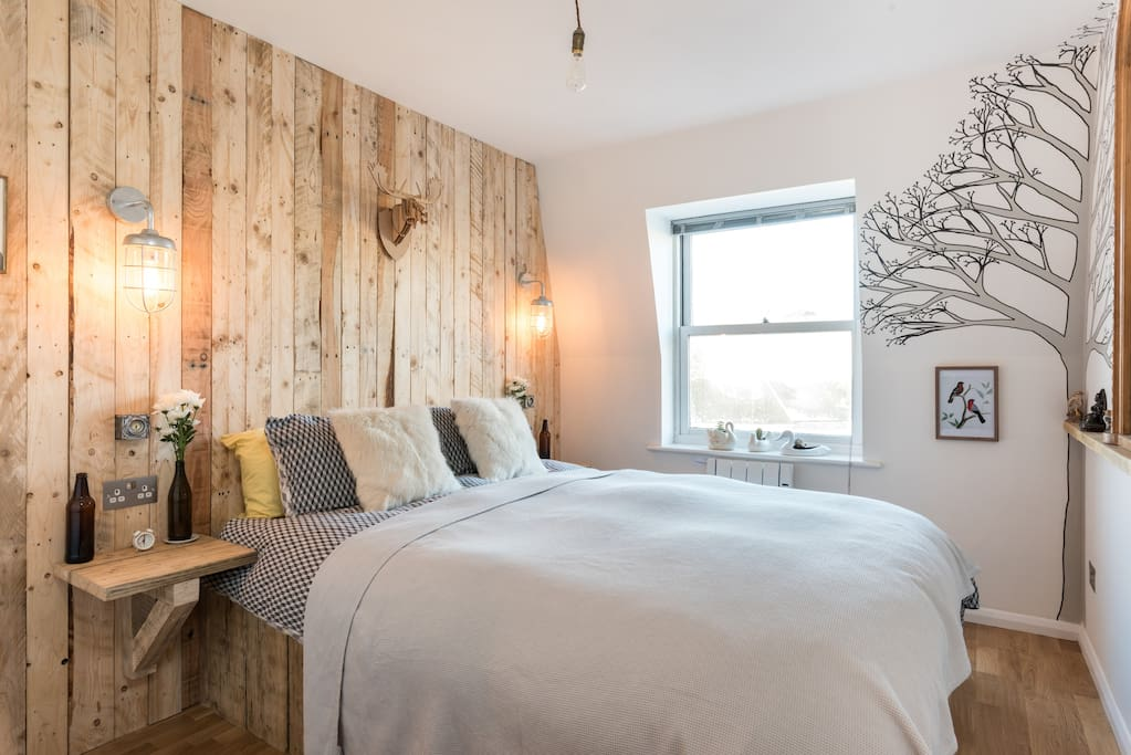 King size bed with feather bedding in winter and fitted wardrobe