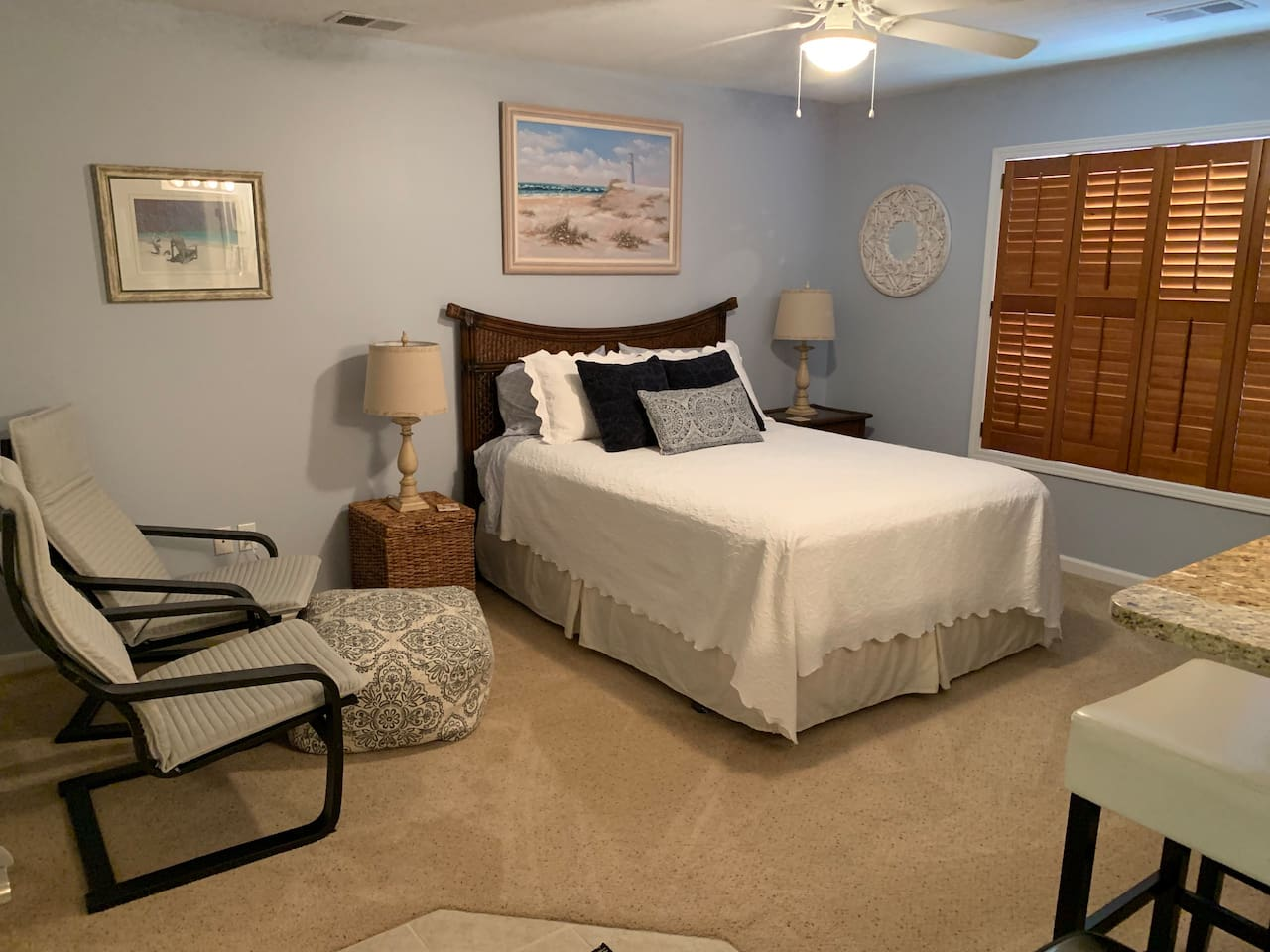 Queen bed and comfortable seating for relaxing