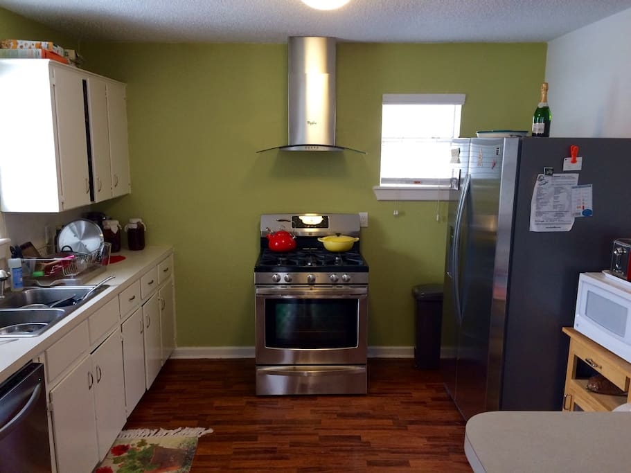Kitchen with tons of space, fridge/dishwasher/microwave, full set of dishes and other cooking necessities available as well!