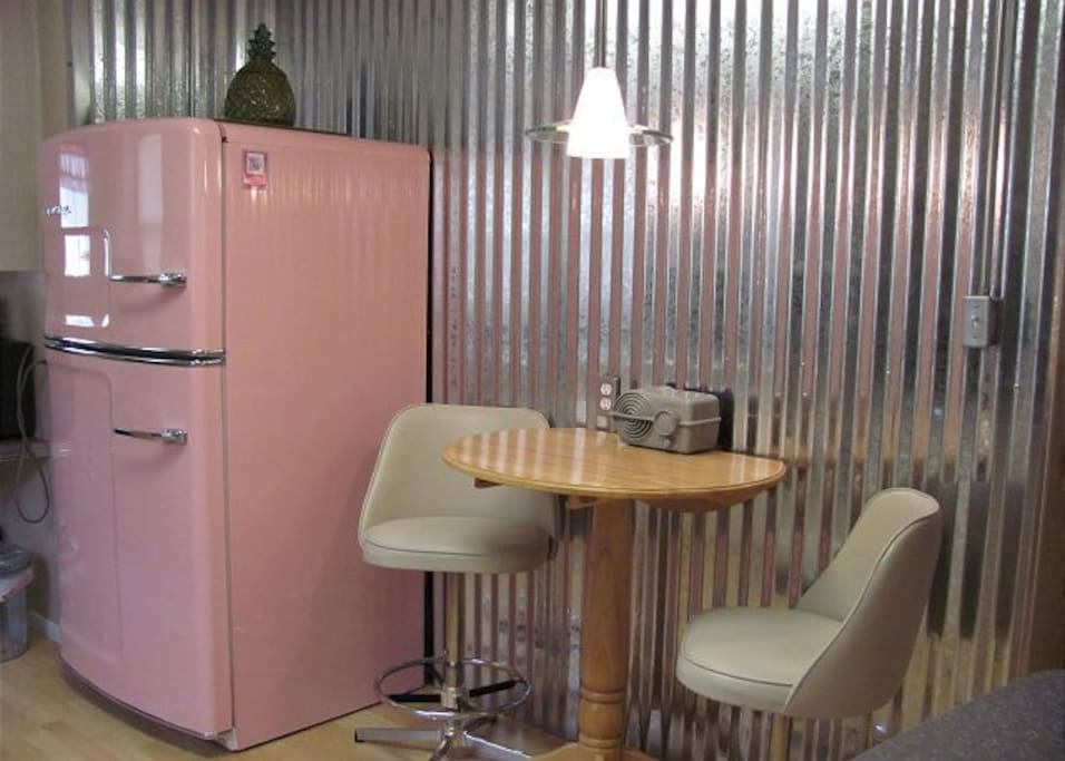 Guests will dig the pink fridge and retro decor throughout.