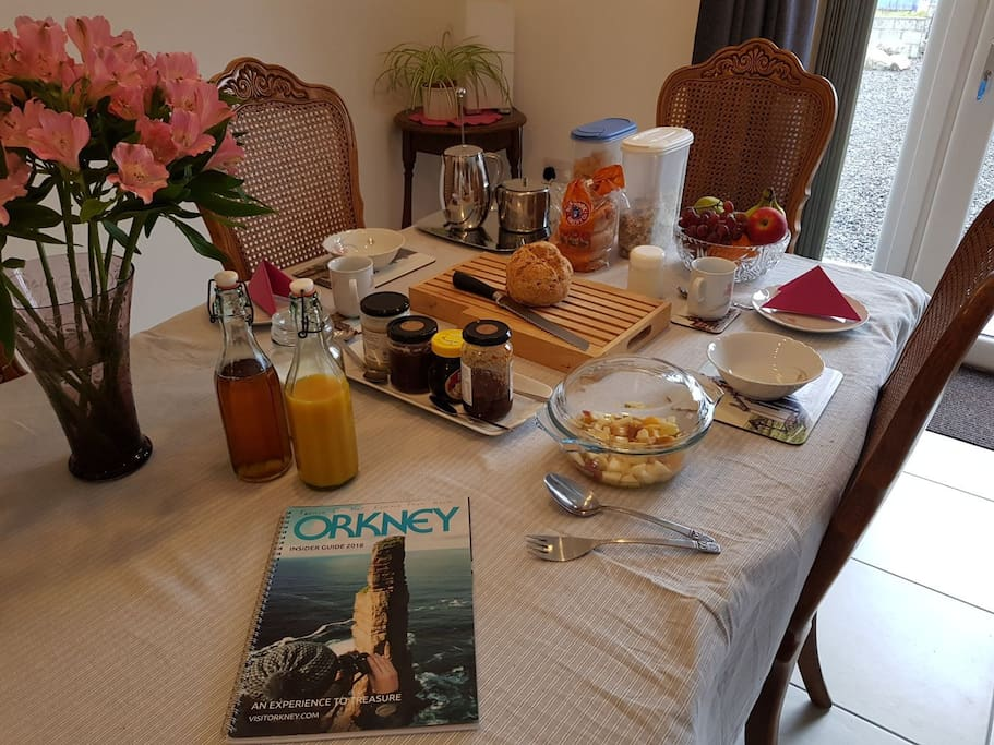 Breakfast, cereal, fruit salad, homemade soda bread, juice and homemade preserves  with tea and coffee