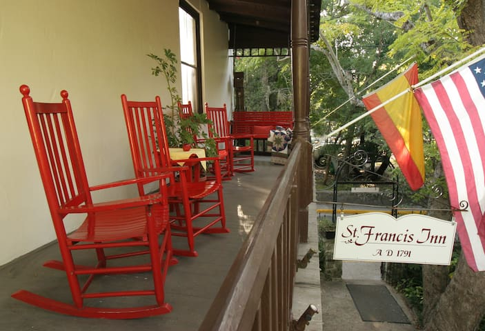 Rockers and a swing await you on the public balcony which overlooks the courtyard.
