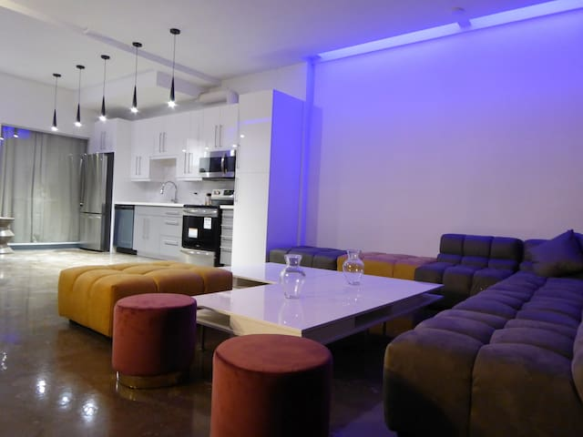 """Massive open concept living/dining with high end modular furniture and 70 """" tv"""