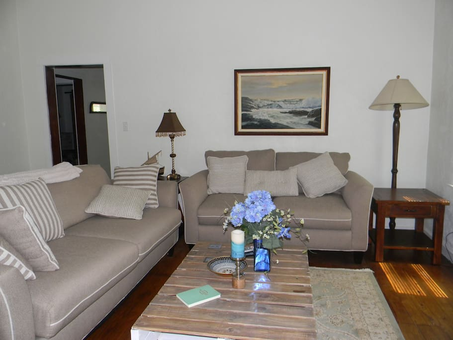 Plenty of seating in living area with flat screen TV