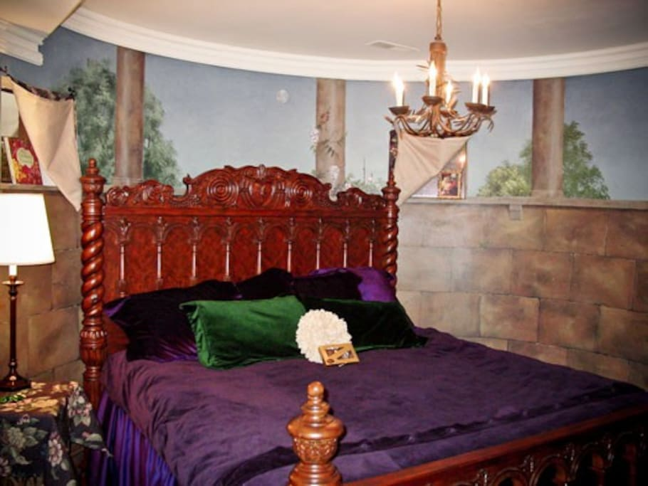 A King sized bed with a beautiful frame