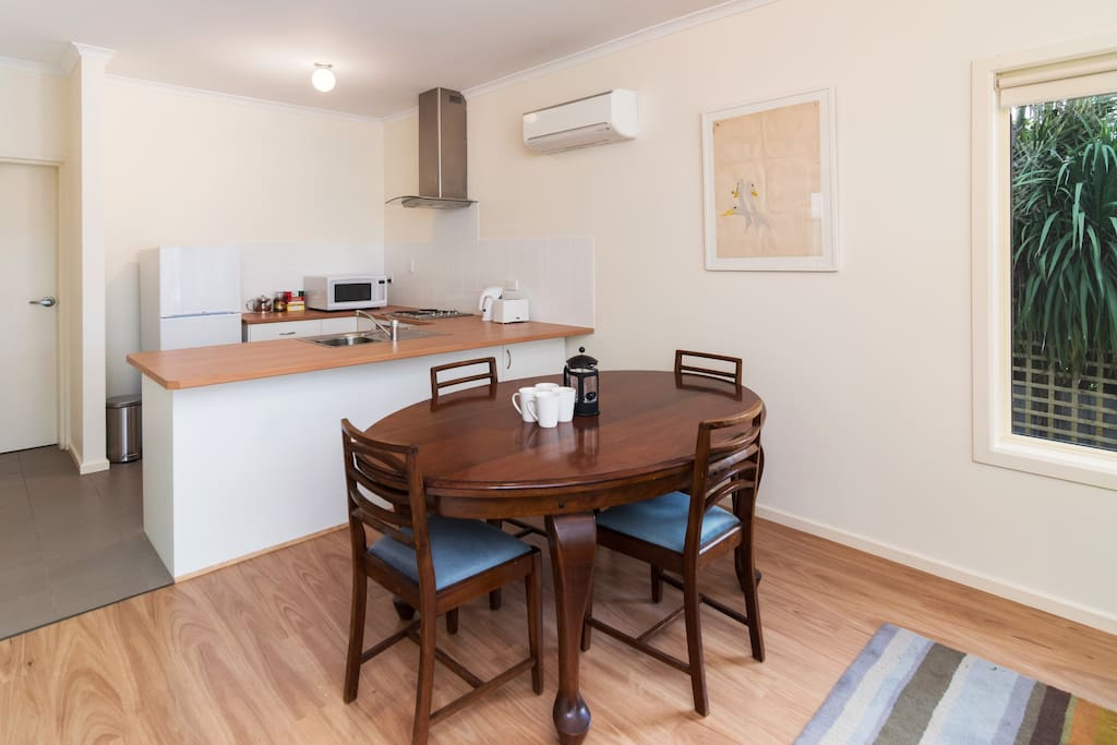 dining area and kitchen with reverse cycle air con and flat screen TV