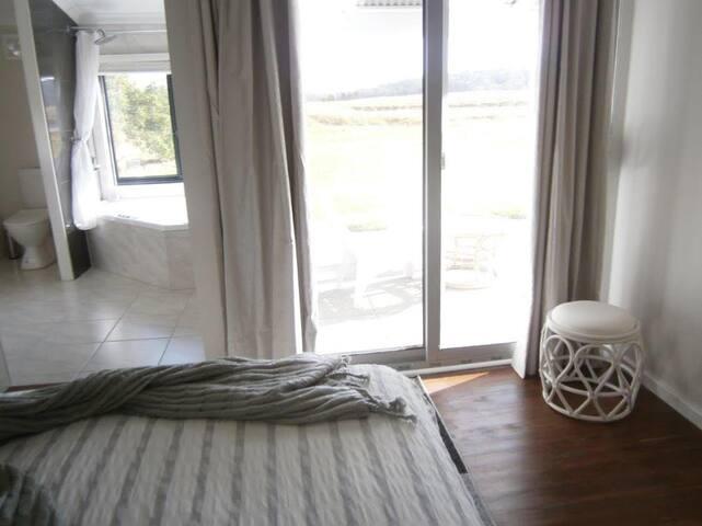 Main bedroom over looking the natural soak.