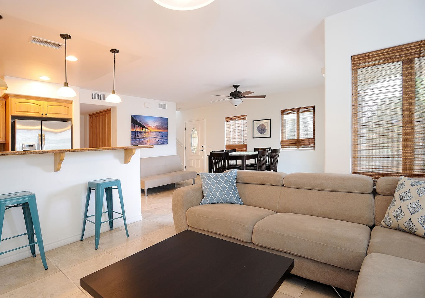 Beautiful open floor plan, perfect for entertaining or hanging with the family. **Please note, since this photo was taken we have replaced the sectional couch with an oversized armchair and a queen size sofa bed.